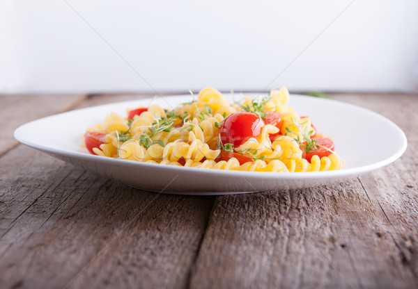 Fussili pasta with watercress and cherry tomatoes. Stock photo © user_11224430