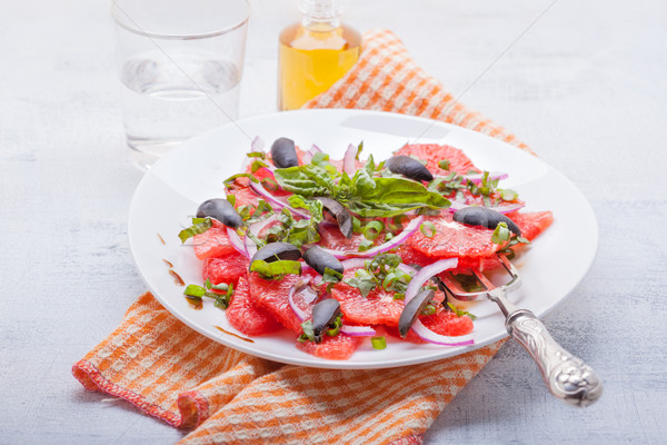 Grapefruit salad with olives, red onion and basil Stock photo © user_11224430