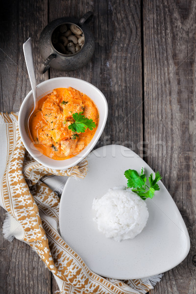 Chicken curry and rice served on a wooden surface. Stock photo © user_11224430