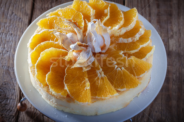 Cheesecake decorated with oranges and physalis Stock photo © user_11224430