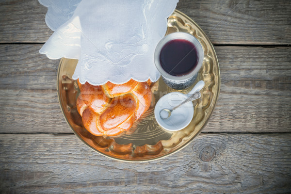 Wine, challah on a wooden surface Stock photo © user_11224430
