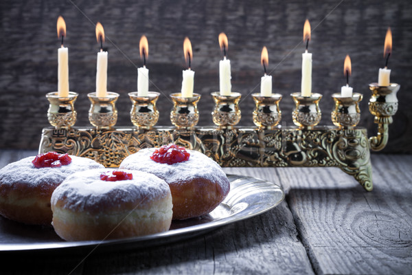 Sufganiyot and nine branched menora for Hanukkah Stock photo © user_11224430