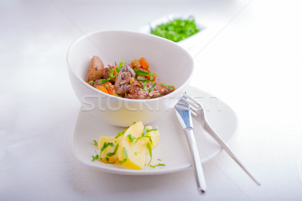 Beef stew, garnished with potatoes and champignons. Stock photo © user_11224430