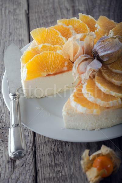 Cheesecake dekore edilmiş portakal kek turuncu plaka Stok fotoğraf © user_11224430