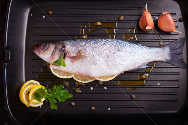 Sea bass with parsley Stock photo © user_11224430