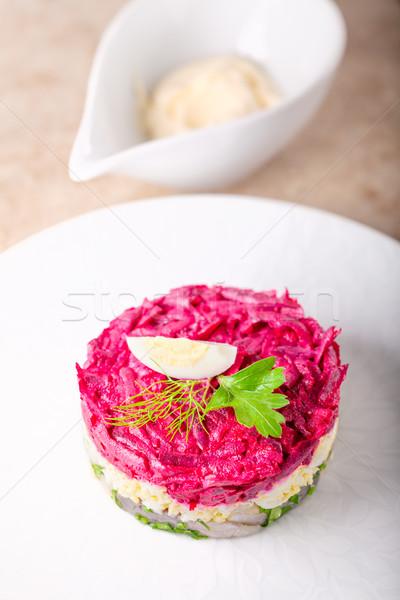 Matjes herring tartare on a white plate Stock photo © user_11224430