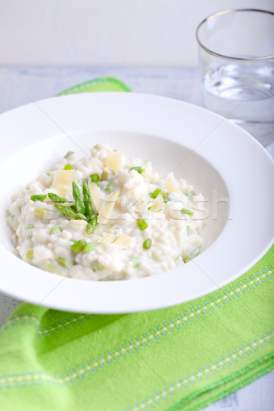 Risotto with Asparagus in a white plate Stock photo © user_11224430