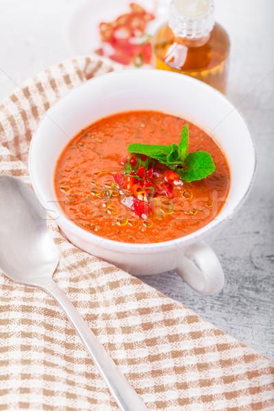 Bowl of fresh tomato soup gazpacho on a napkin Stock photo © user_11224430