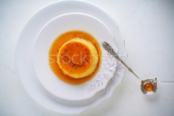 Caramelo casero cuchara leche placa crema Foto stock © user_11224430