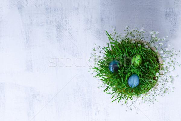 Huevos flores blanco Pascua símbolos hierba Foto stock © user_11224430
