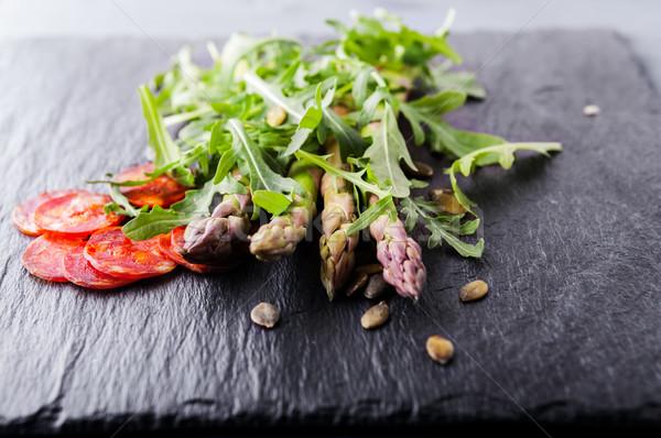 Espargos salada chorizo legumes frescos fatias pedra Foto stock © user_11224430