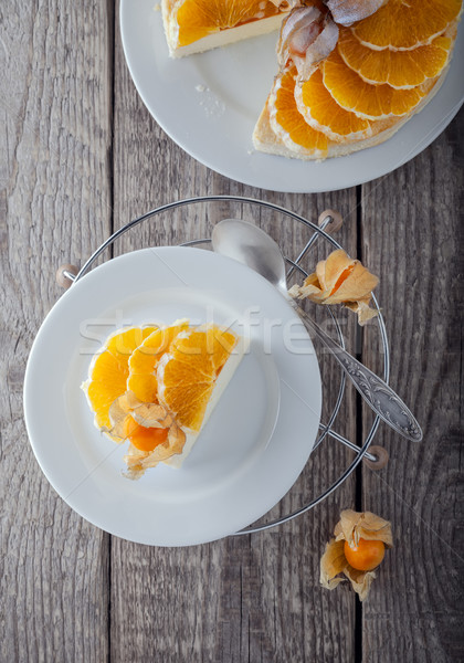 Cheesecake decorated with oranges and physalis. Stock photo © user_11224430