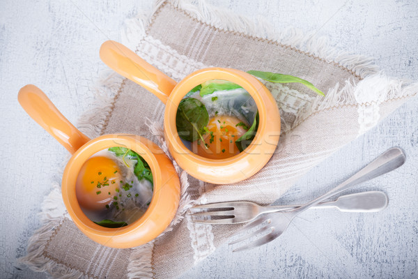 Baked eggs with spinach Stock photo © user_11224430