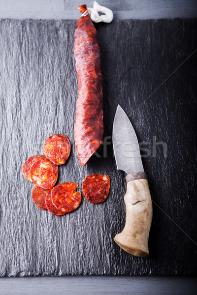 Spanish chorizo and a knife Stock photo © user_11224430