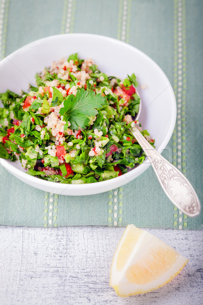 Quinoa tabbouleh salad on a wooden table Stock photo © user_11224430