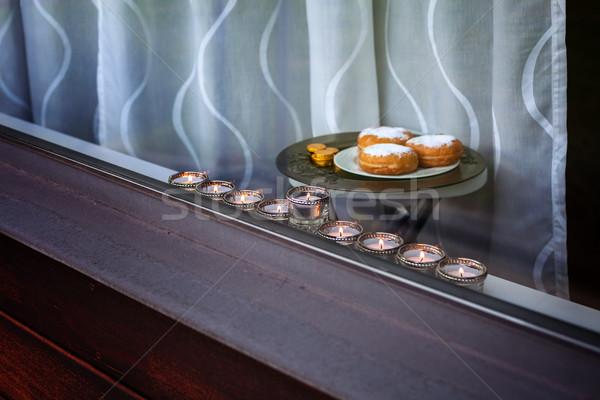 Nine-branched mehorah Hanukiah in the window Stock photo © user_11224430