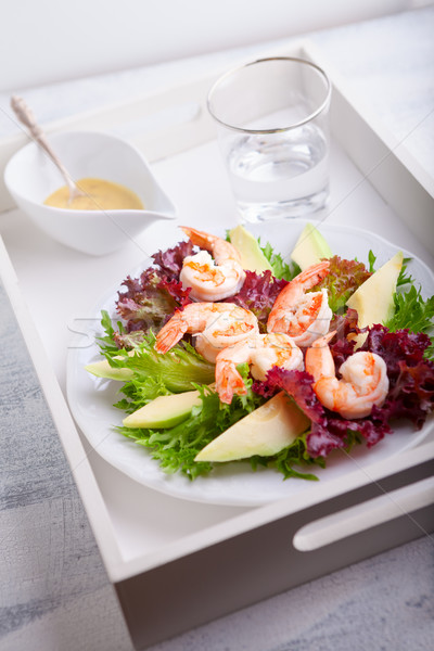 Avocado shrimp salad with mustard sauce on a tray Stock photo © user_11224430