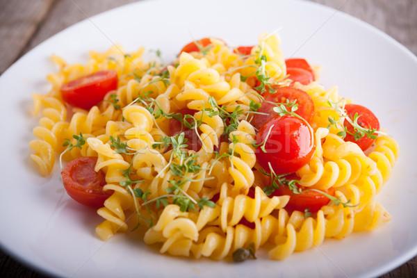 Macarrão tomates cereja comida queijo prato fundos Foto stock © user_11224430