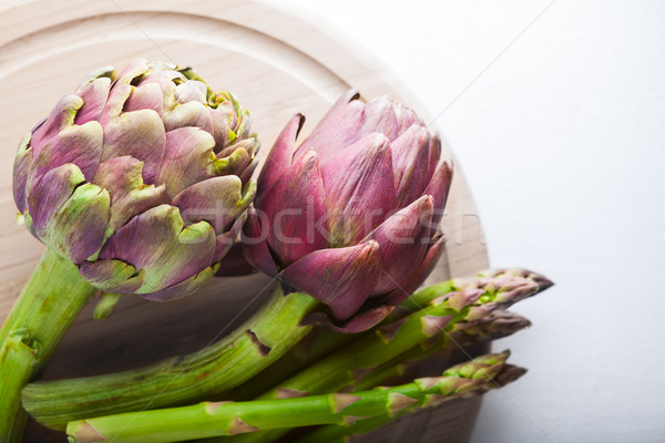 Artichokes and asparagus on a wooden board Stock photo © user_11224430
