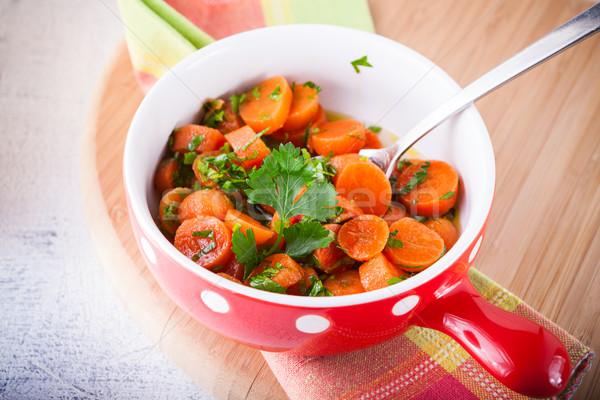 Baby wortelen gekookt knoflook honing peterselie Stockfoto © user_11224430