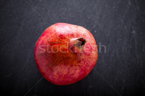 Fresh Red Pomegranate placed on a stone plate. Stock photo © user_11224430