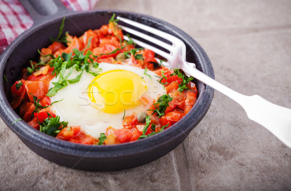 Traditional Middle Eastern dish of Shakshuka in a pan. Stock photo © user_11224430