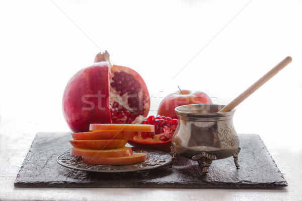 Apples, pomegranate and honey for Rosh Hashanah  Stock photo © user_11224430