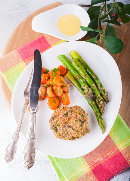 Meat rissole with glazed carrots, asparagus on the plate. Stock photo © user_11224430