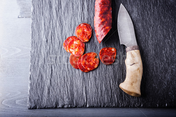 Spanish chorizo and a knife Stock photo © user_11224430