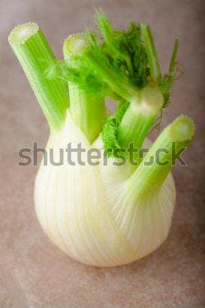 Fresh vegetarian food. Fennel on a wooden surface Stock photo © user_11224430