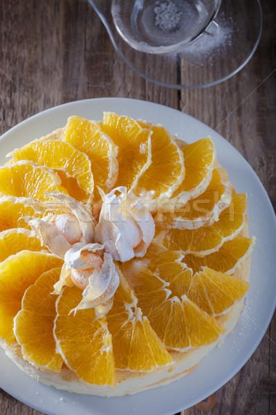 чизкейк украшенный апельсинов деревянный стол торт оранжевый Сток-фото © user_11224430