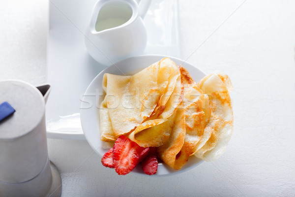 Crepes with strawberries and coffee Stock photo © user_11224430