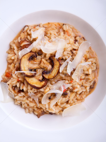 Mushroom risotto Italian cuisine placed on a white background. Stock photo © user_11224430