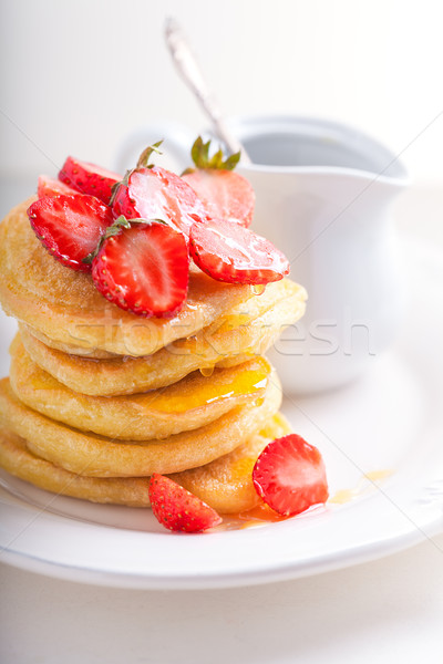 Stack of sweet pancakes with strawberry and honey. Stock photo © user_11224430