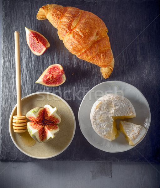 Croissant with soft cheese and figs on a stone plate Stock photo © user_11224430