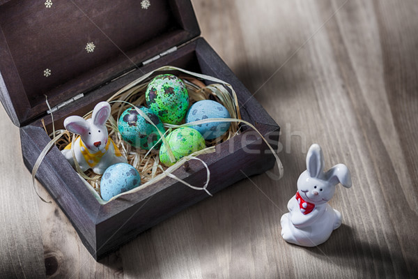 Easter bunny with colorful eggs in a box. Stock photo © user_11224430