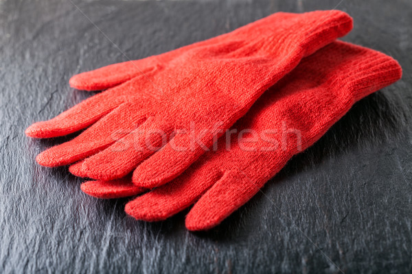Red gloves on black background Stock photo © user_11224430