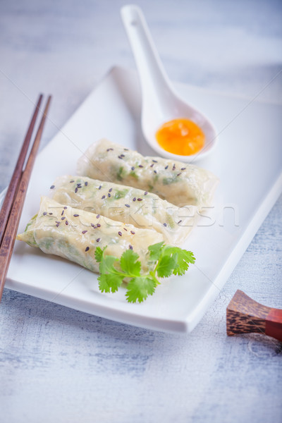 Spring Rolls with Sauce served on the plate Stock photo © user_11224430