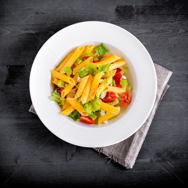 Penne pasta salad with fresh tomato and salad. Stock photo © user_11224430