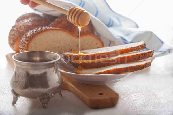 Braided Challah bread and honey  Stock photo © user_11224430