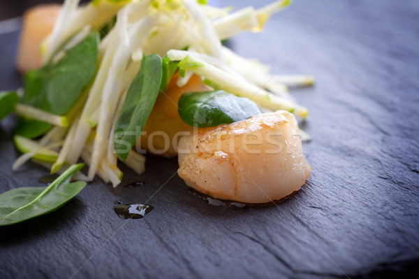 Scallop salad with apple, spinach on a stone plate. Stock photo © user_11224430
