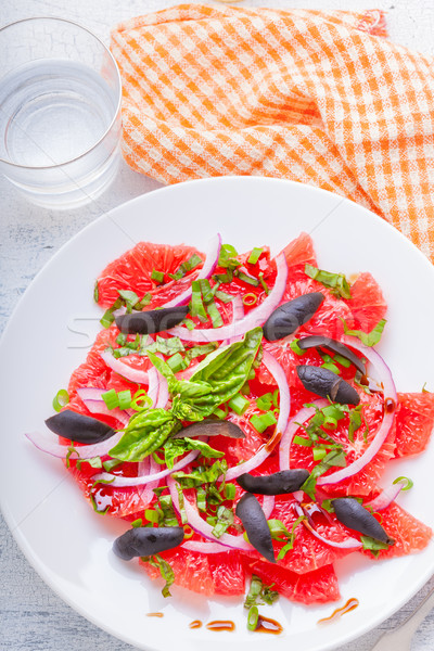 Grapefruit salad with olives, red onion, basil Stock photo © user_11224430