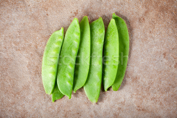 Stock photo: Green peas on ceramic surface