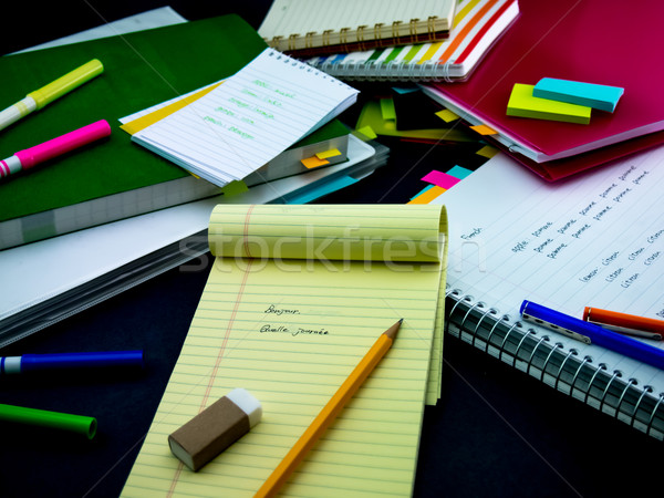 Learning New Language Writing Words Many Times on the Notebook;  Stock photo © user_9323633