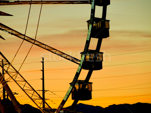 Detail And Silhouette of Ferris Wheel with Sun Set Stock photo © user_9323633