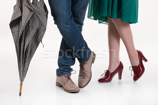 женщину человека зонтик ног изолированный студию Сток-фото © user_9834712