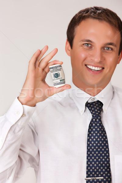 Fiatalember dollár portré tart izolált pénz Stock fotó © user_9834712