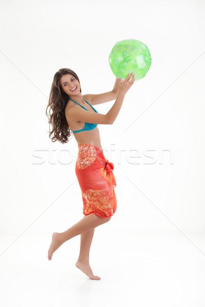 Młoda kobieta gry piłka młodych piękna kobieta odizolowany Zdjęcia stock © user_9834712