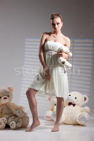Fiatal menyasszony játékok gyönyörű nő esküvői ruha nagy Stock fotó © user_9834712