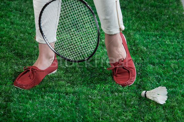 Woman's Legs And Badminton Racket Stock photo © user_9834712